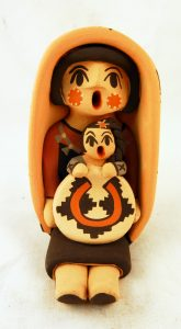 A Jemez Pueblo storyteller figurine with one child by Chrislyn Fragua