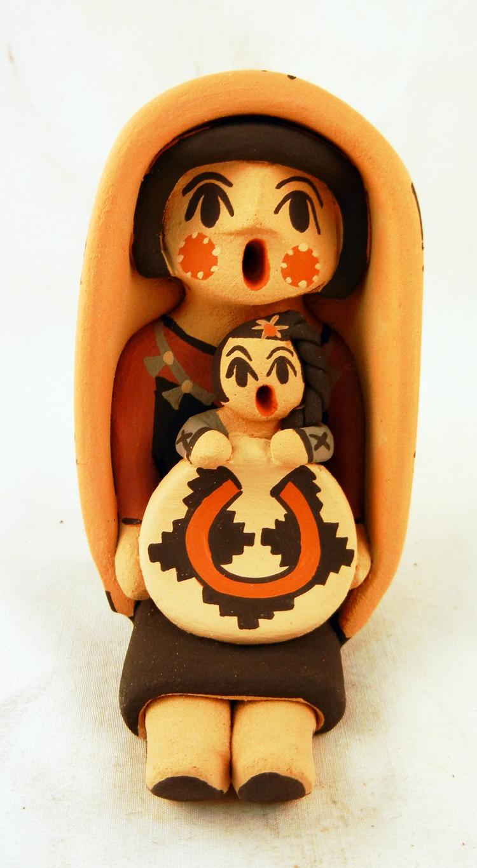 A Jemez Pueblo storyteller figurine with one child by Chrislyn Fragua