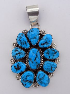 Navajo Sleeping Beauty Turquoise and Sterling Silver Rosette Pendant