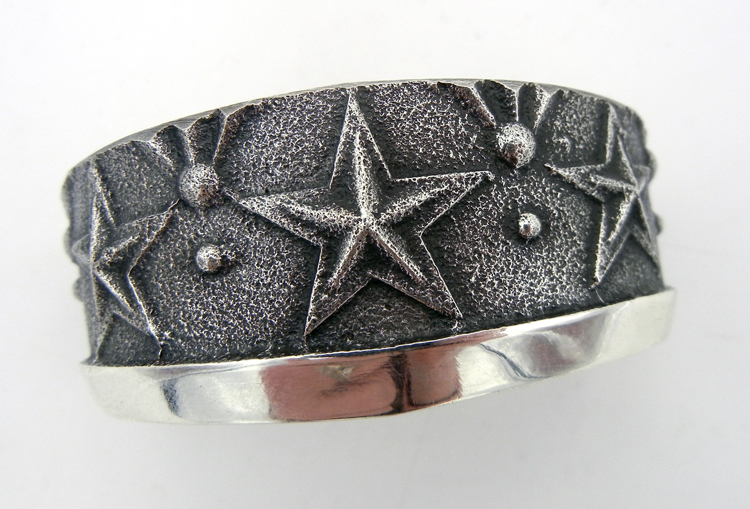 Tufa cast sterling silver cuff bracelet featuring star patterns by Navajo silversmith Anthony Bowman