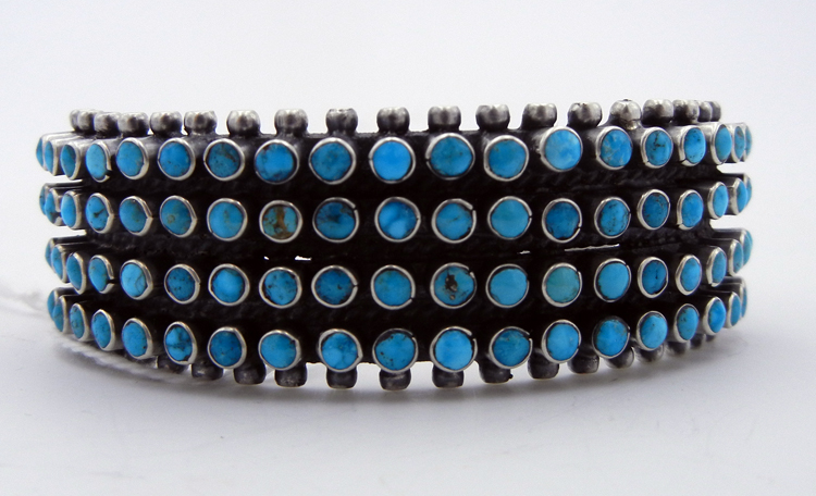 Navajo Kingman turquoise row cuff with 80 stones by Raymond Betsoi