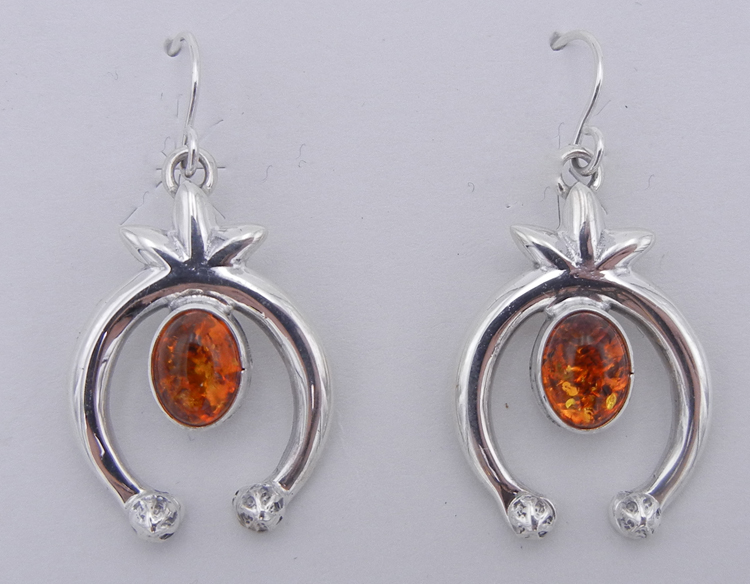 A pair of Navajo amber and sterling silver naja earrings