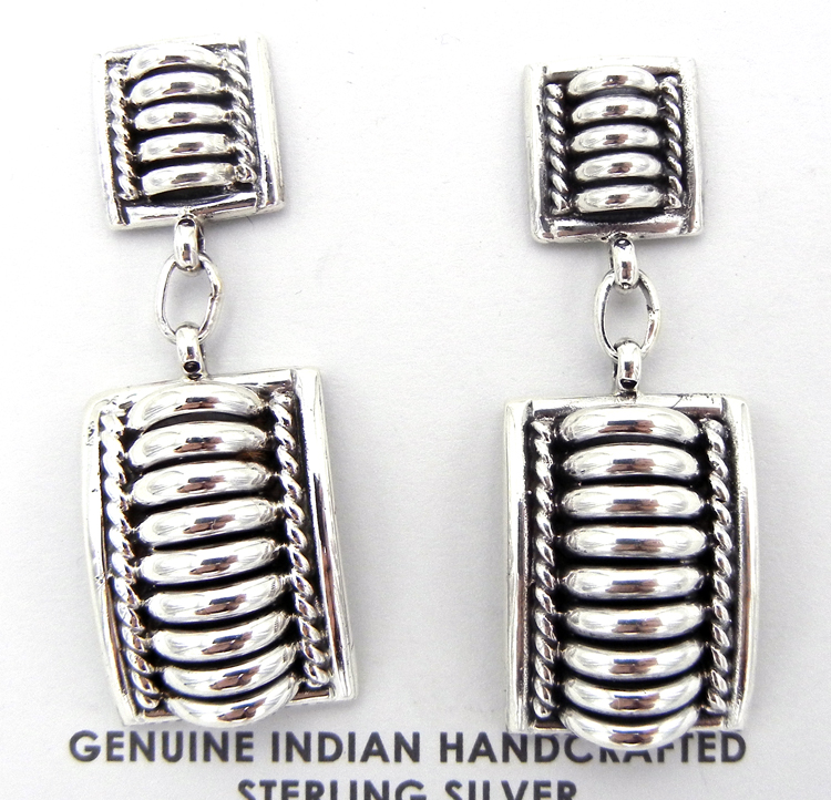 Sterling silver dangle earrings by Navajo silversmith Thomas Charley