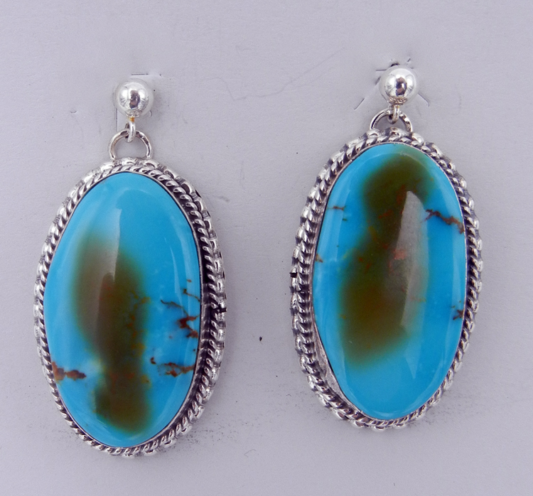 Pair of Kingman turquoise Navajo earrings with sterling silver accents
