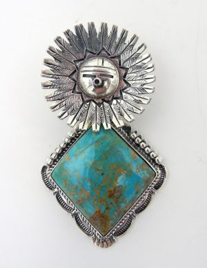 Sterling silver and turquoise sunface pendant by Navajo silversmith Bennie Ration