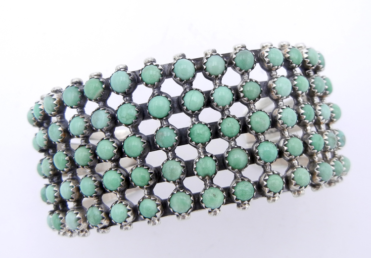 Navajo Kingman turquoise and sterling silver row cuff bracelet consisting of five rows of fourteen stones