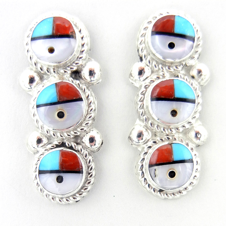 A pair of traditional Zuni sunface earrings inlaid with turquoise, jet, mother of pearl and coral