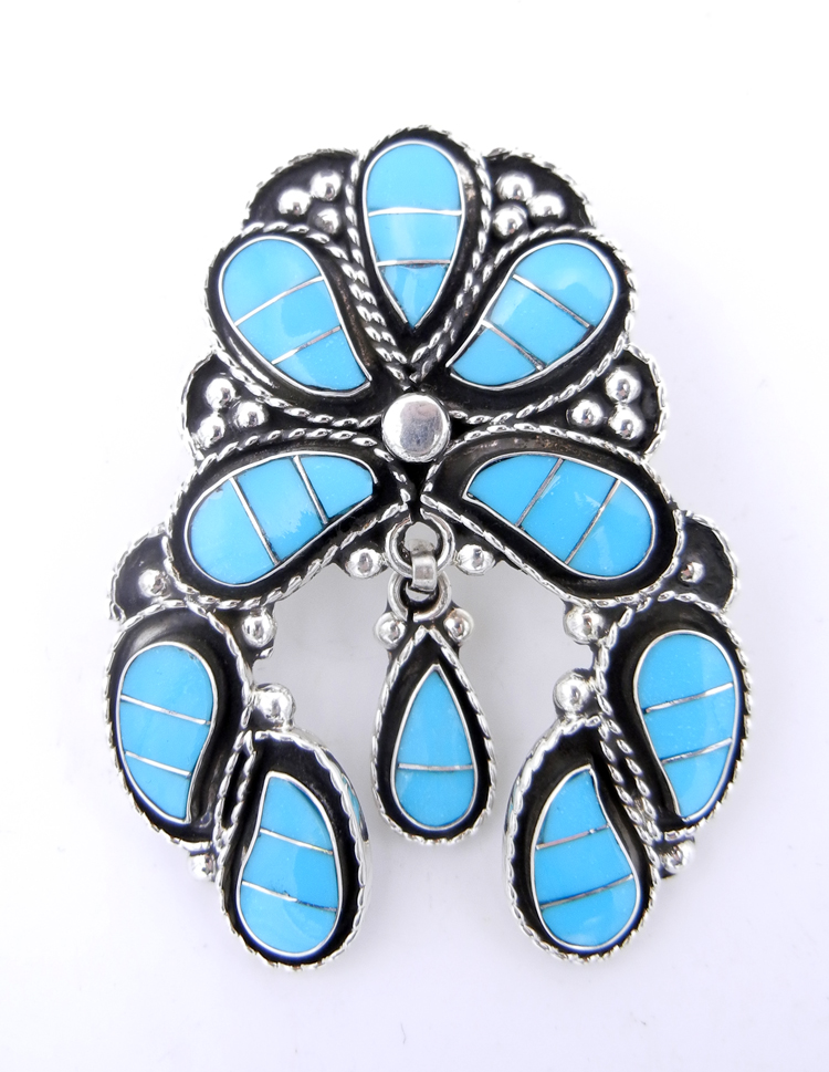 Zuni naja pendant featuring inlaid turquoise and sterling silver