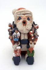 A Santa storyteller with eight children by Jemez potter Deborah Kiki Loretto