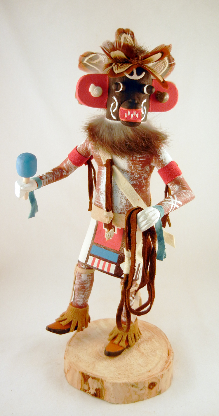 A Navajo Ogre Kachina by Arvin Morris featuring feathers and leather