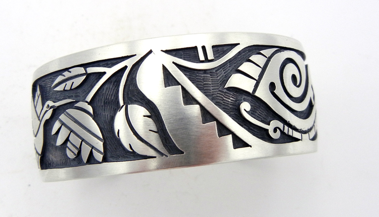 Hopi sterling silver overlay cuff bracelet featuring a hummingbird and butterfly