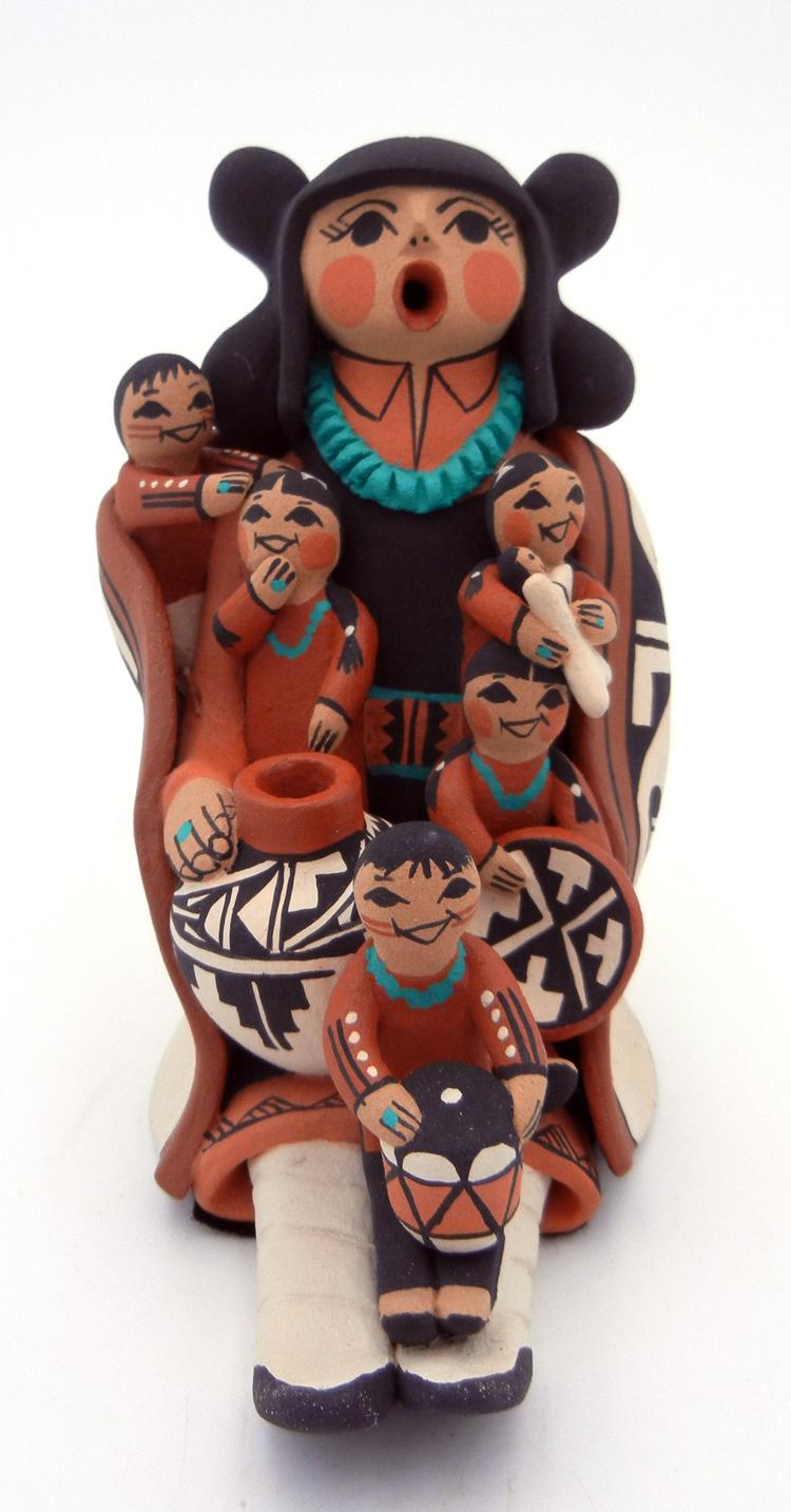 Jemez seated storyteller with five children by Carol Lucero Gachupin