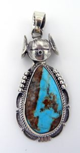Navajo turquoise and sterling silver maiden pendant by Bennie Ration
