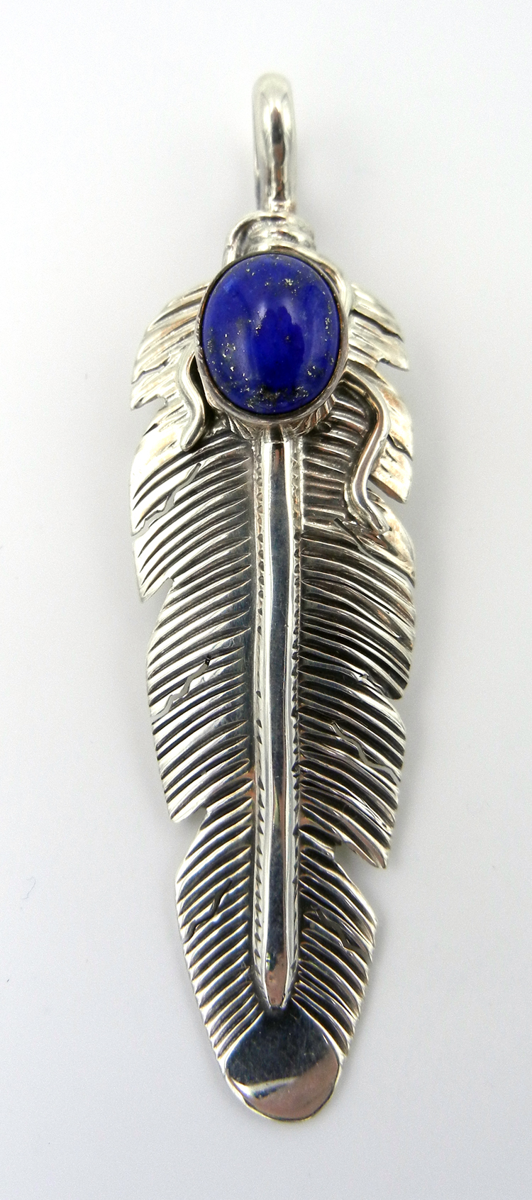 Navajo lapis and sterling silver feather pendant by June Defauito