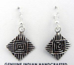 Sterling silver tufa cast earrings by Santo Domingo silversmith Gilbert Dino Garcia