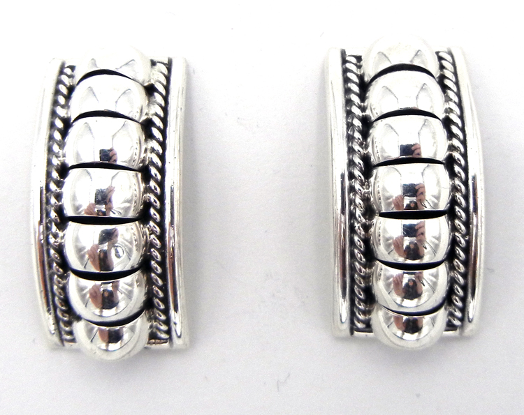 Navajo domed sterling silver earrings by Thomas Charley
