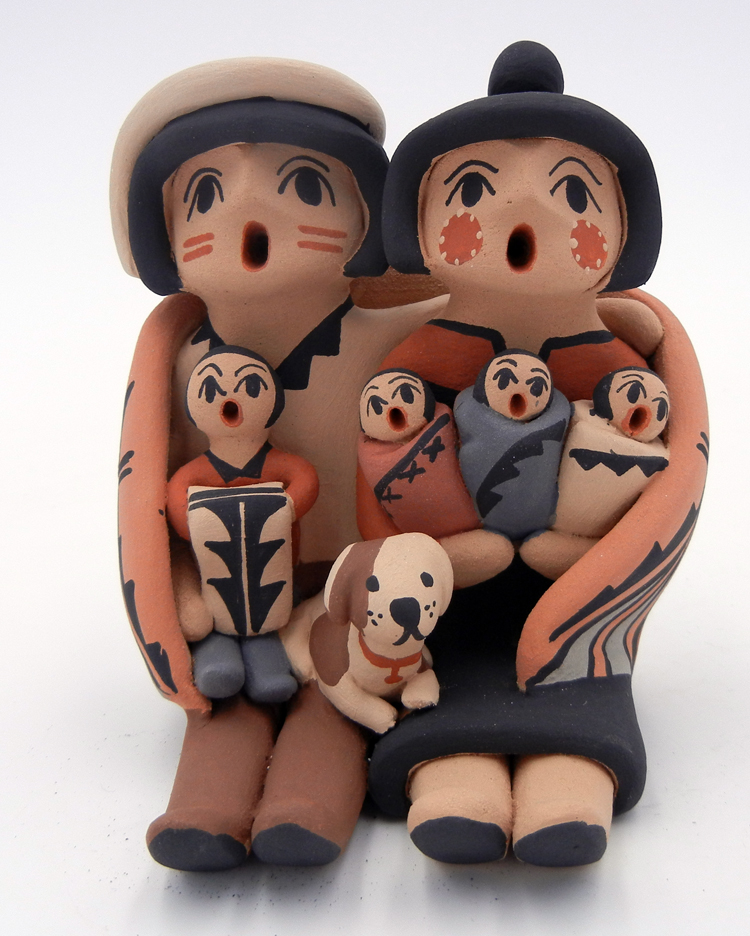 Jemez storyteller couple with four children and dog by Chrislyn Fragua