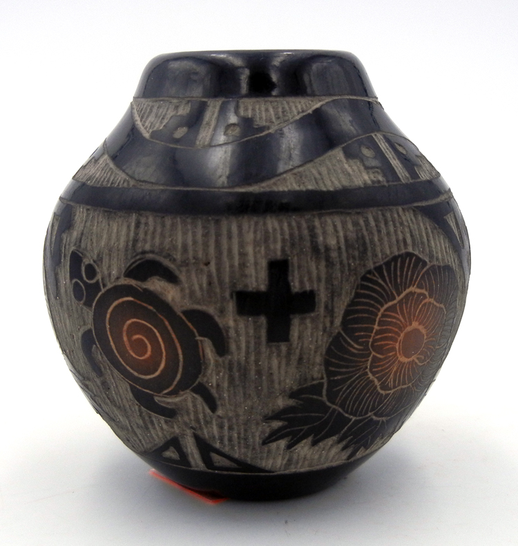 Santa Clara small etched and polished black jar by Melvin Moquino featuring avanyu serpent, flowers and turtles