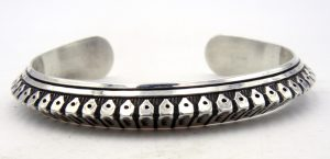 Navajo sterling silver hand stamped triangle cuff bracelet by Randy Secatero
