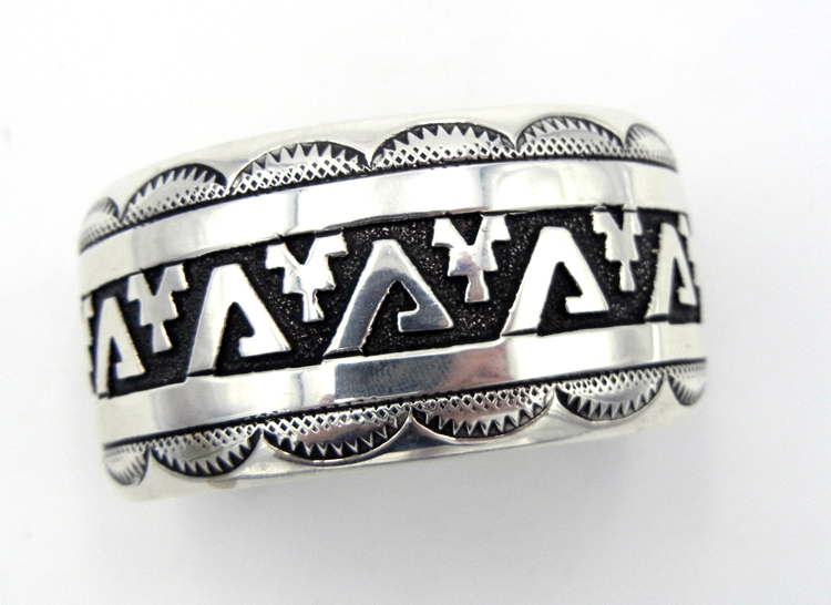 Navajo sterling silver overlay cuff bracelet featuring traditional patterns by Rosita Singer