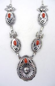 Navajo sterling silver and coral maiden and sunface necklace by Bennie Ration
