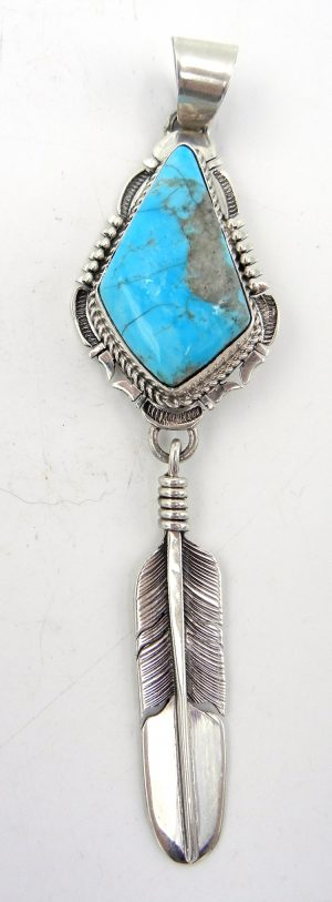Navajo turquoise and sterling silver feather pendant by Bennie Ration