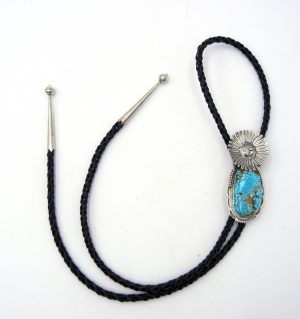 Navajo turquoise and sterling silver sunface bolo tie by Bennie Ration