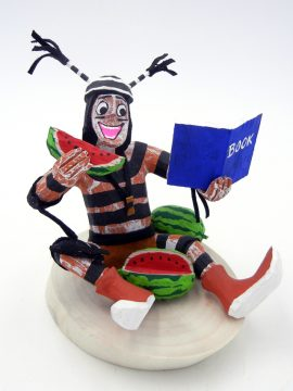 Navajo Bertha Wood Seated Koshare Kachina with Book and Watermelon