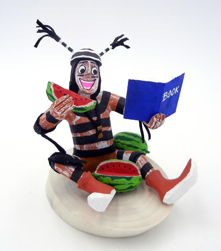 Navajo Bertha Wood Seated Koshare Kachina with Book and Watermelon