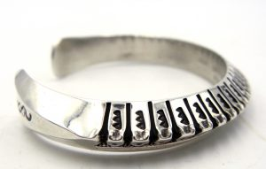 Navajo hand stamped sterling silver triangle cuff bracelet by Randy Secatero