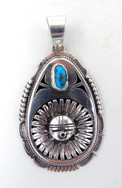 Navajo sterling silver and turquoise sunface pendant by Bennie Ration