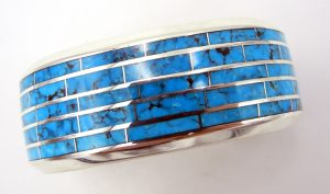 Navajo turquoise and sterling silver wide channel inlay cuff bracelet by Larry Loretto