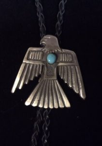 Sandcast sterling silver and turquoise thunderbird bolo tie by Navajo silversmith Eugene Mitchell