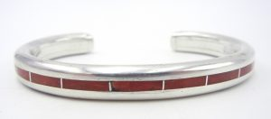 Navajo coral and sterling silver channel inlay cuff bracelet by Larry Loretto