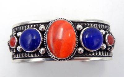 Navajo multi-stone and sterling silver cuff bracelet featuring orange spiny oyster, lapis, and coral
