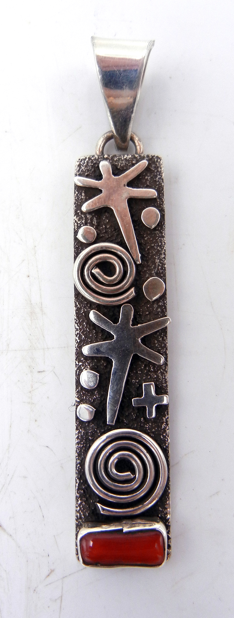 Navajo Alex Sanchez Sterling Silver and Coral Petroglyph Style Pendant