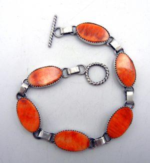 Navajo orange spiny oyster shell and brushed sterling silver link bracelet
