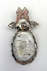 Navajo white buffalo and sterling silver maiden pendant by Bennie Ration