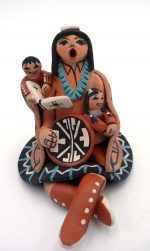 Jemez seated storyteller with two children by Carol Lucero Gachupin