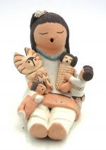 Isleta seated storyteller with two children, corn maiden and morning singer kachina by Stella Teller
