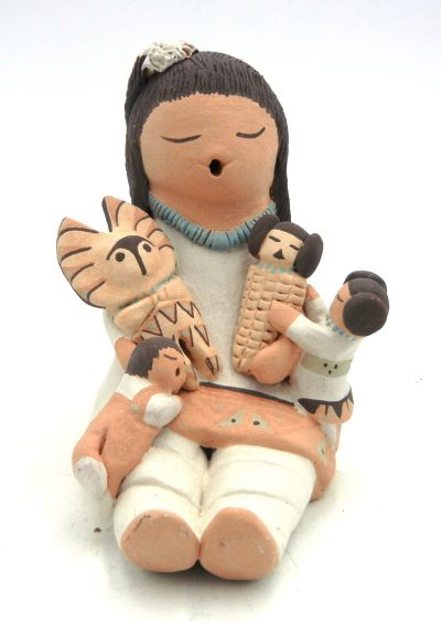 Isleta seated storyteller with two children, corn maiden and morning singer kachina by Stella Teller