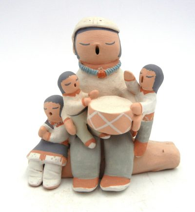 Isleta male storyteller with three chidlren and drum by Stella Teller
