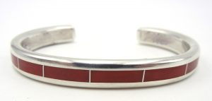 Navajo coral and sterling silver channel inlay row cuff bracelet by Larry Loretto