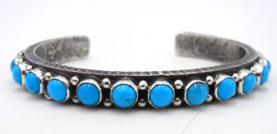 Navajo turquoise and sterling silver row cuff bracelet