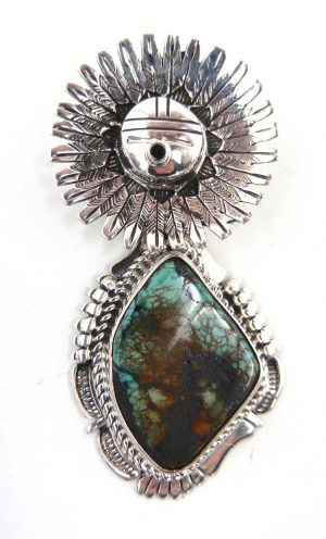 Navajo turquoise and sterling silver sunface pendant by Bennie Ration