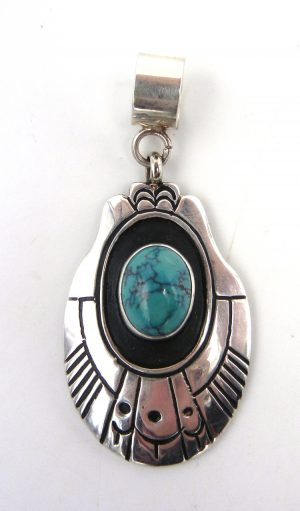 Navajo sterling silver overlay and turquoise pendant by Rosita Singer