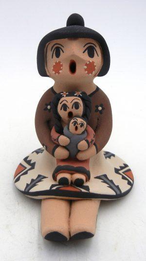 Jemez seated storyteller with two children by Chrislyn Fragua