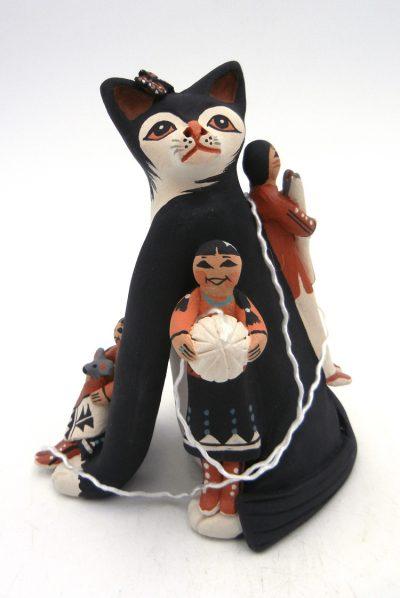 Jemez Carol Lucero Gachupin black cat storyteller with three children