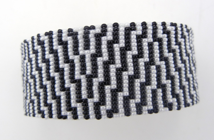 Navajo black and white beaded cuff bracelet by Weltin Hoffman