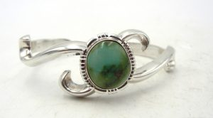 Navajo sandcast sterling silver and turquoise cuff bracelet